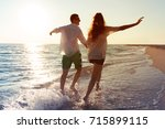 happy young couple enjoying the ... | Shutterstock . vector #715899115