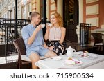 eating in restaurant  happy... | Shutterstock . vector #715900534