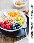 porridge withe fresh fruits   Shutterstock . vector #715909339