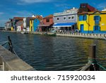 set of colored houses along the ... | Shutterstock . vector #715920034