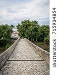 arta's bridge on a cloudy day   Shutterstock . vector #715934854