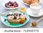 bruschettas with fresh ripe... | Shutterstock . vector #715935775