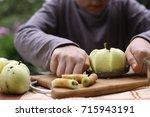 apple knife cutter with cut...   Shutterstock . vector #715943191