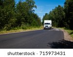 white van on the asphalt road.... | Shutterstock . vector #715973431