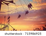 people riding rides and... | Shutterstock . vector #715986925