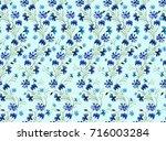 watercolor pattern of flowers... | Shutterstock . vector #716003284