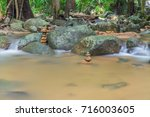 dreamy waterfall and rocks ... | Shutterstock . vector #716003605