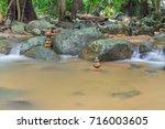 dreamy waterfall and rocks ... | Shutterstock . vector #716003605