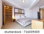 interior of a hotel bedroom | Shutterstock . vector #716039305