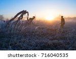 a hunter with a gun outdoors   Shutterstock . vector #716040535