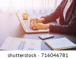 a young business woman using... | Shutterstock . vector #716046781