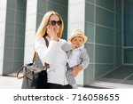 mother going to work and... | Shutterstock . vector #716058655