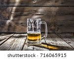 Small photo of Craft beer. A half-drunk glass of beer