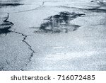 water puddles with raindrops... | Shutterstock . vector #716072485