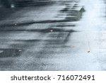 view of street pavement wet... | Shutterstock . vector #716072491
