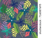 printed leaves of tropical... | Shutterstock .eps vector #716087695