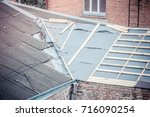 roof repair in the old house | Shutterstock . vector #716090254