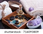 aromatic oil with hot stones... | Shutterstock . vector #716093809