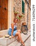 beautiful pretty woman walking... | Shutterstock . vector #716096299