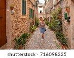 beautiful pretty woman walking... | Shutterstock . vector #716098225