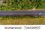 top view of asphalt road passes ... | Shutterstock . vector #716106937