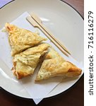 crispy chicken pie with wooden... | Shutterstock . vector #716116279