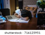 woman sleeping on desk while... | Shutterstock . vector #716125951