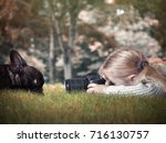little girl photographing a dog | Shutterstock . vector #716130757