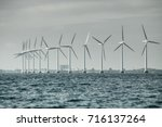 vertical axis wind turbines... | Shutterstock . vector #716137264