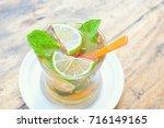 iced tea with lemon. | Shutterstock . vector #716149165