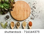 wooden board and lettuce with... | Shutterstock . vector #716164375