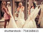 attractive young bride is... | Shutterstock . vector #716168611