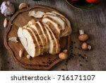 delicious sliced turkey breast... | Shutterstock . vector #716171107