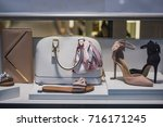 shoes and purses in a store in... | Shutterstock . vector #716171245