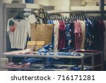 clothing storefront in paris | Shutterstock . vector #716171281