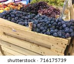 blue plums and other fruits in... | Shutterstock . vector #716175739