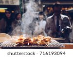 grilled seafood scallop and sea ... | Shutterstock . vector #716193094