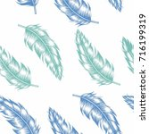 seamless colorful feather on... | Shutterstock .eps vector #716199319