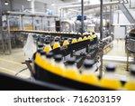 industrial factory indoors and... | Shutterstock . vector #716203159