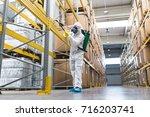 pest control worker hand... | Shutterstock . vector #716203741
