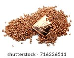 Small photo of copper ingot and granules isolated on white background