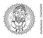 ganesha on the ornate mandala... | Shutterstock .eps vector #716234695