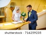 Small photo of The newlyweds put their signatures on. Wedding ceremony. Man and woman on wedding day