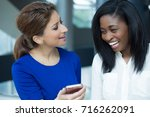 closeup portrait two women... | Shutterstock . vector #716262091