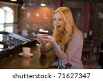 the charming girl drinks coffee ... | Shutterstock . vector #71627347