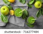 tasty green smoothie and... | Shutterstock . vector #716277484