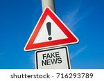 Small photo of Fake News - traffic sign with exclamation mark to alert, warn caution - precaution and warning of false information, hoax, disinformation, misleading misinformation, propaganda and manipulation