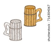 a mug made of wood. for beer ... | Shutterstock . vector #716304067
