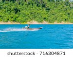 boat in rajjaprabha dam of... | Shutterstock . vector #716304871