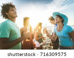 multicultural group of friends... | Shutterstock . vector #716309575